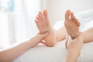 Heilmassage-Fußreflexzonenmassage-Triggerpunkttherapie